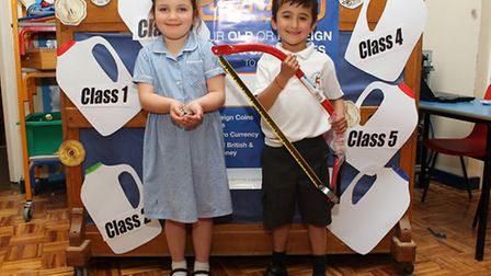 Sandridge School year 1 students Ruby Randall and Matisse Allin-Parmar with foreign currency collect