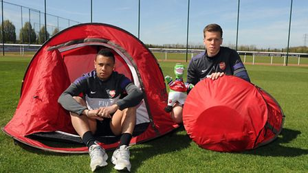 Francis Coquelin and Wojciech Szczesny - pictured recently at Arsenal's training grounds in London C