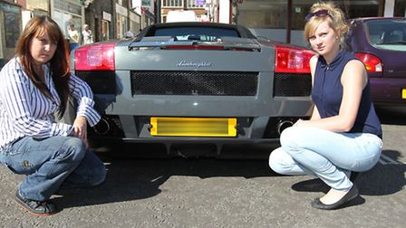 Samantha Mawditt with her daughter Olivia Long, with Samantha's Lamboghini which youths climbed on a