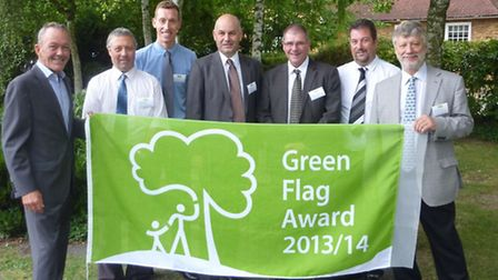 NHDC officers and Cllr Burt celebrate the success of four Green Flag winners for North Herts in this