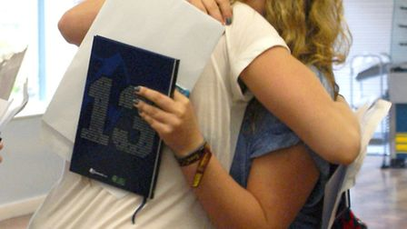 Two happy students from St Albans High School for Girls share a hug after opening their GCSE results