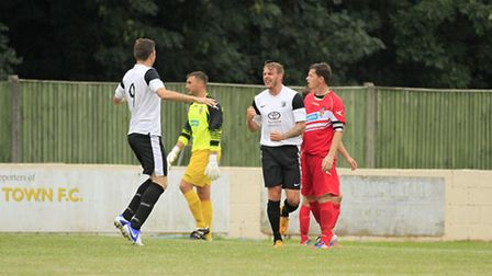Royston's Robbie Mason is congratulated by his team-mates