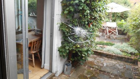 A Harpenden resident was shocked at having ball bearings shot at her house. A window on her patio wa