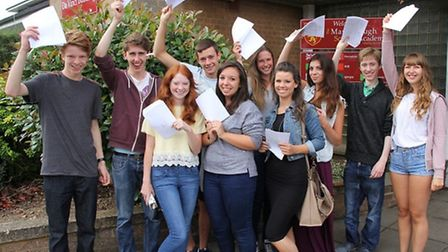 Pupils from Marlborough Science Academy wave their results in the air