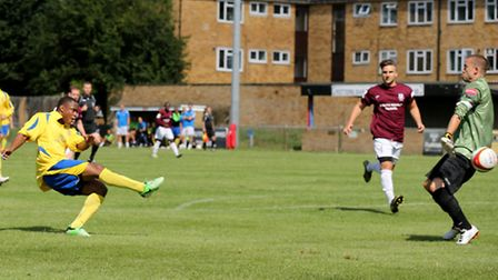Greg Ngoyi powers the ball into the net against Potters Bar. Picture by Leigh Page