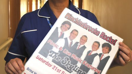 The Skyliners playing for Woodlands Appeal, Andrea Brennan with the poster