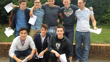 Boys from St Columba's pose with their results