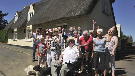 Residents outside the Royal Oak pub, Hail Weston, celebrating their proposal to buy (and save) the p