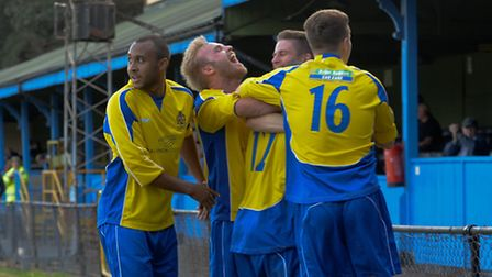 James Comley, Richard Graham and Elliot Bailey celebrate Chris Henry's (12) winning goal. Picture by