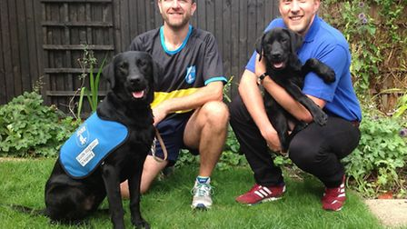 Kevin Hayes is in the black top with Guide Dog puppy Oakley (12 months old) and his friend David Raw