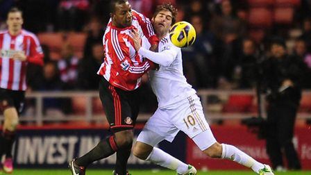 Sunderland's Titus Bramble and Swansea's Danny Graham (right) in action during the Barclays Premier