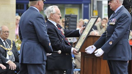 WW2 Pathfinder Veteran Colin Bell accepts the freedom of the district scroll, at Market Hill, Huntin