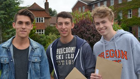 William Forrester, Harry Holland and John Treasure clutch their A-level results