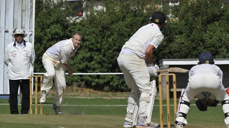 Godmanchester Town bowler Paul Jefferson in their match against Ramsey on Saturday. Picture: Helen D