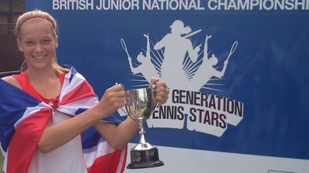 Kira Reuter win her national 12 and under trophy.
