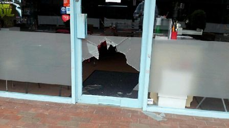 Thieves smashed the glass door of Chaos City Comics on Tuesday morning