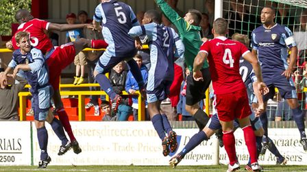 Goalkeeper Niall Conroy punches the ball clear for St Neots. Picture: Claire Howes