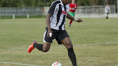Goalscorer Dubi Ogbonna is flourishing in the black and white of St Ives. Picture: Louise Thompson