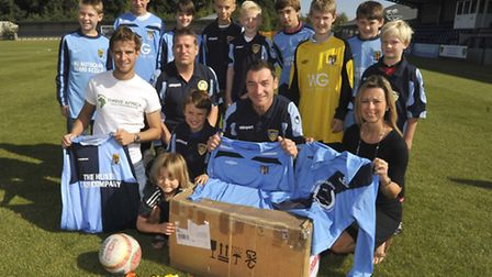 After a trip to Ghana (far left) Tom Davies has organised for St Neots Football Club to send kit ove