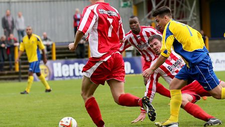 Matt Taylor powers through a crowded Stourbridge penalty area. Picture by Leigh Page