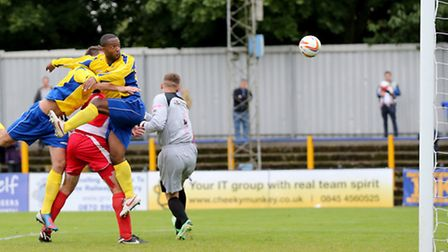 Mark Nwokeji can not direct his header towards goal. Picture by Leigh Page