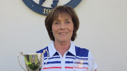 Ann Holahan with her trophies.