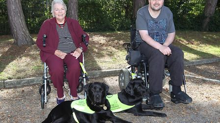 Marie Carden with her dog Blue and Andy Lee with Rufus