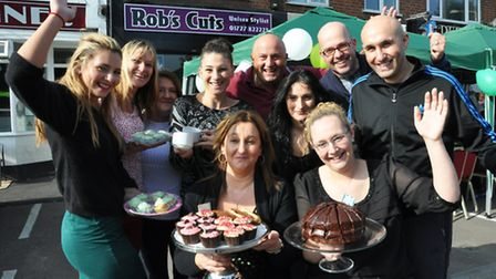 Staff at Rob's Cuts in London Colney show off their baked goods
