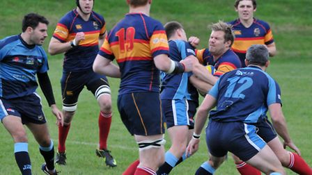 Tabard's stand-off Jack Reilly feeling the crunch of an Eton Manor tackle.