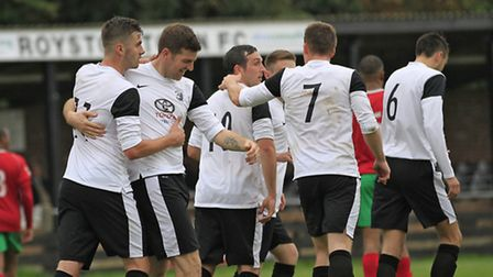 Royston celebrate scoring against Chalfont St Peter. Picture by Kevin Richards.