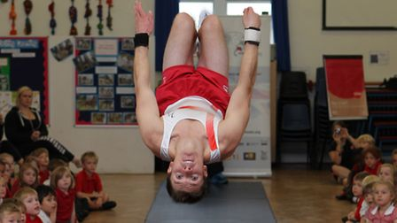 GB gymnast Danny Lawrence performs a backflip for Manland pupils
