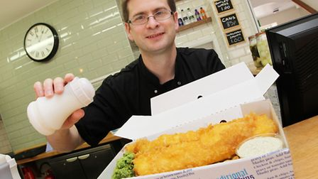 Owner of Godfrey's Luke Godfrey serves up a portion of fish and chips