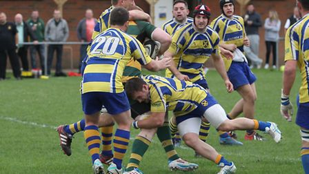 Several St Albans players tackle a Beaconsfield player