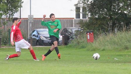 A Vision Res player scores his sides opening goal against AFC Welwyn.