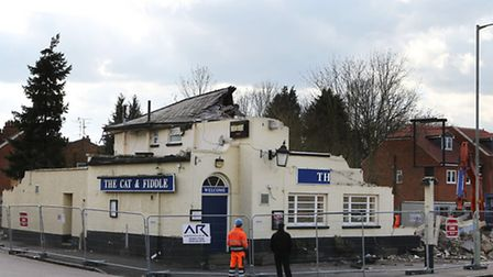 The Cat and Fiddle pub on St Albans Road West being demolished