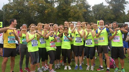 Some of the Tom's Trust runners in Chariots of Fire do the T for Tom sign