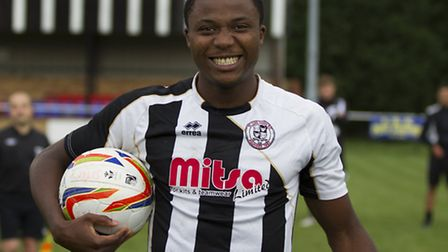 St Ives Town striker Dubi Ogbonna with the match ball after scoring his FA Cup hat-trick. Picture: L