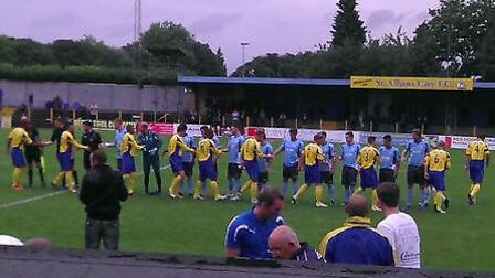 St Albans City and Enfield Town shake hands prior to their FA Cup tie.