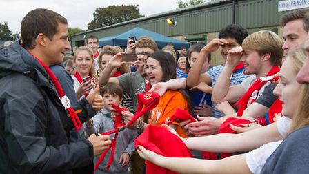 Bear Grylls signs the scarves of Harpenden Gang Show cast members - photo by Richard Washbrooke Phot