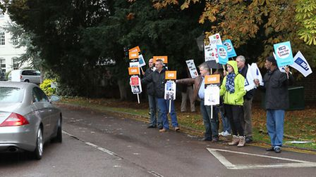 Protesters lobby in front of Sopwell House Hotel where MP Michael Gove was due to speak