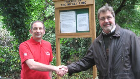 Joinery manager Carl Sturges presents the information board to Dave Abernethy