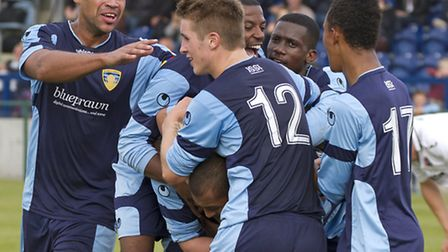 Karl Saffe (head) is congratulated by team-mates after scoring for St Neots. Picture: Claire Howes