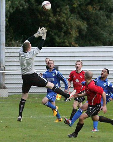 Martin Collins lobs Tring goalkeeper Michael Underwood from inside the box. Picture: James Whittamor