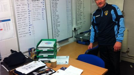 OFFICE WORKER: Iain Parr with his youth teams' squad lists in his office at The Cozy Stadium.