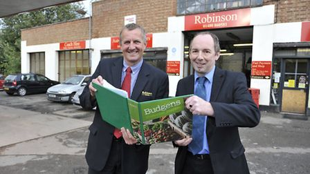 A new Budgens store will open in Robinsons Garage at Kimbolton, (l-r) Charles Robinson looking at pl