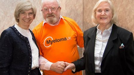 Dr Jenny Craig, consultant oncologist (l), Barry Love (c) and raffle prizewinner Margaret Wright
