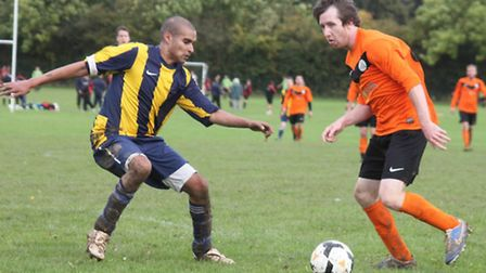 Brookmans Park's Stevie Lane takes on a Kings Langley player.
