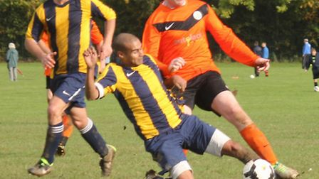 A Kings Langley player gets in a tackle to stop a Brookmans Park Res player.