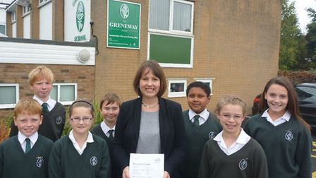 Greneway Middle School head teacher Laura Rawlings with pupils and the school's good Ofsted report