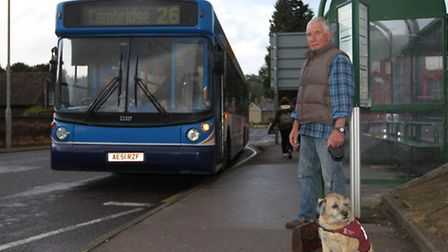 Tony McMurray at the bus stop with his Dog Mac